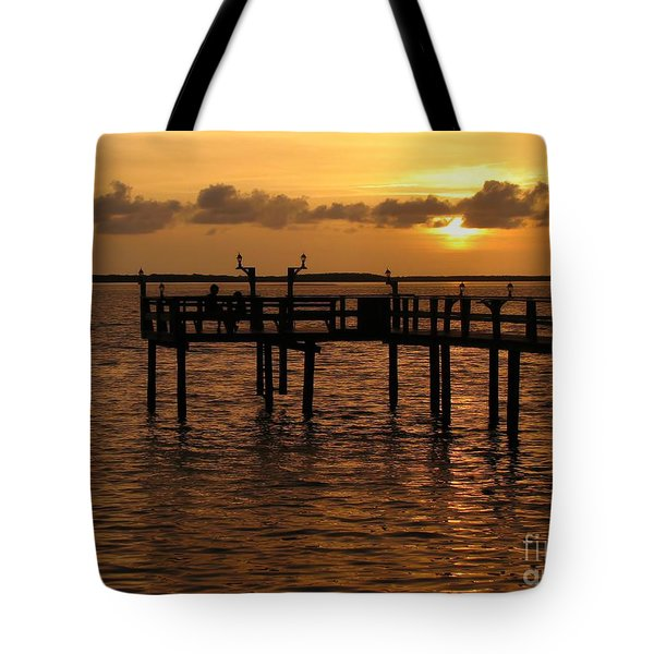 Sunset On The Dock Tote Bag by Peggy Hughes