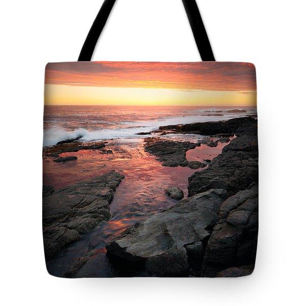 Sunset Over Rocky Coastline Tote Bag