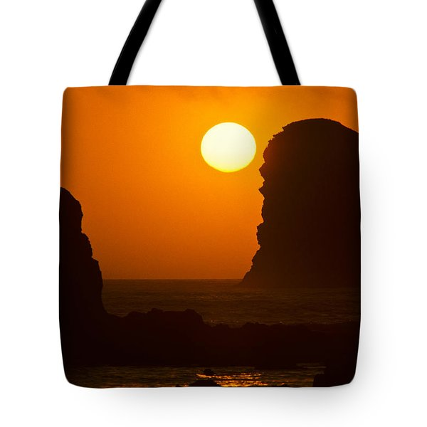 Tote Bag featuring the photograph Sunset Over The Pacific Ocean With Rock Stacks by Jeff Goulden