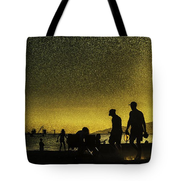 Tote Bag featuring the photograph Sunset Silhouette Of People At The Beach by Peter v Quenter
