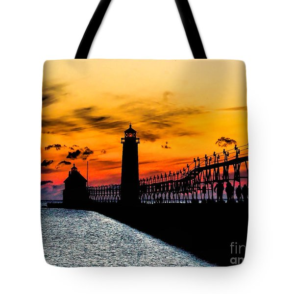 Sunset Walking On Grand Haven Pier Tote Bag