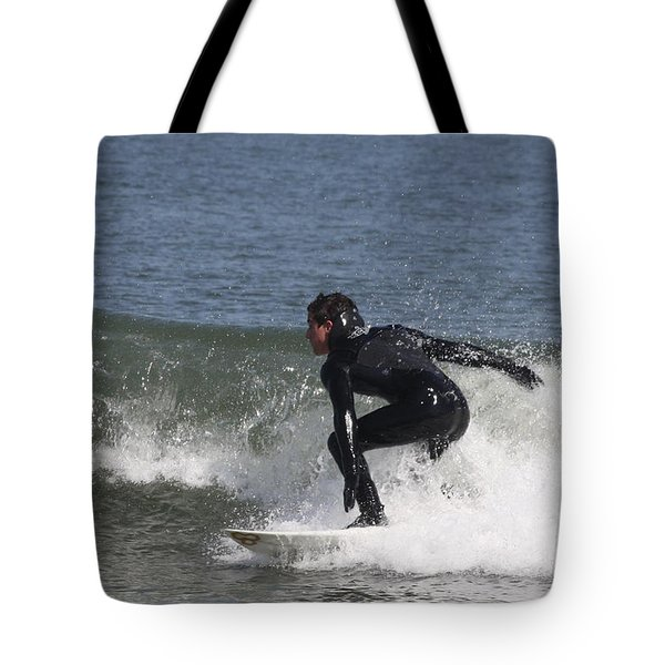 Tote Bag featuring the photograph Surfer Hitting The Curl by John Telfer