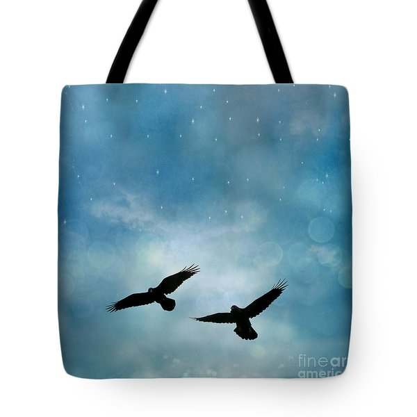 Surreal Ravens Crows Flying Blue Sky Stars Tote Bag by Kathy Fornal