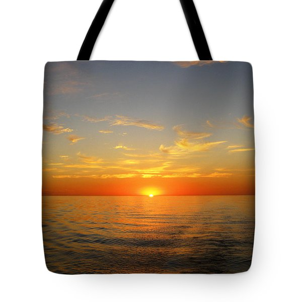 Surreal Sunrise At Sea Tote Bag by Anne Mott