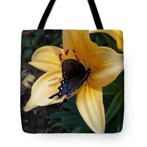 Tote Bag featuring the photograph Swallowtail On Asiatic Lily by Kathryn Meyer