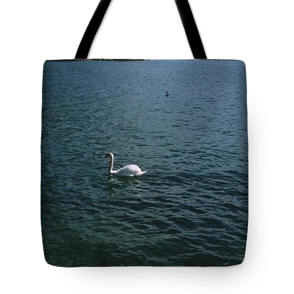 Swan Swimming In A Lake With A Castle Tote Bag