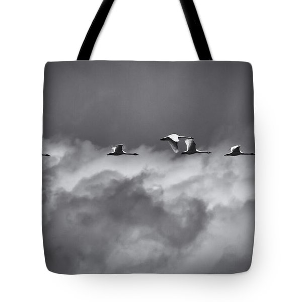 Swans Flying With The Storm Tote Bag