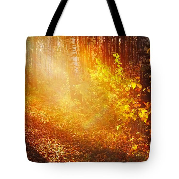 Swimming In Golden Light Tote Bag by Jenny Rainbow