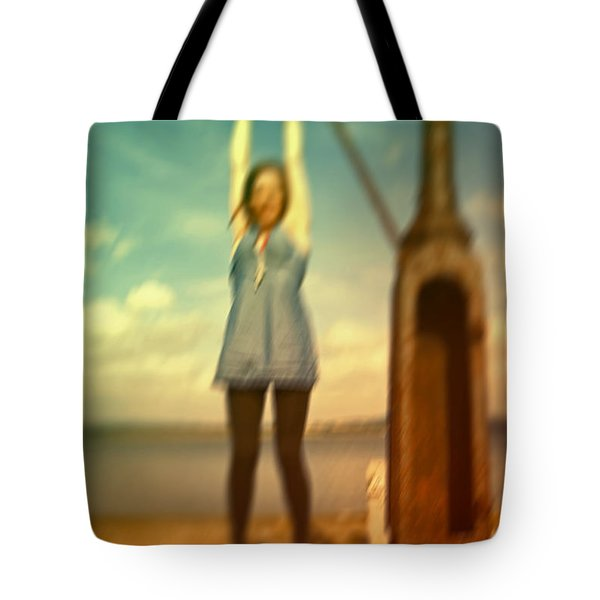 Tote Bag featuring the photograph Swinging From Lampost  by Craig B
