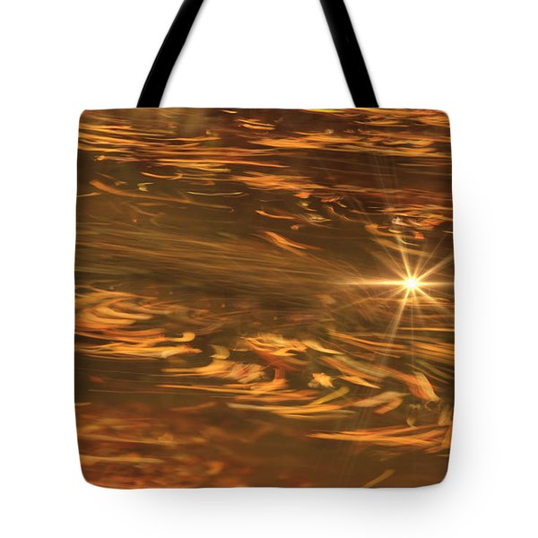 Tote Bag featuring the photograph Swirling Autumn Leaves by Geraldine DeBoer