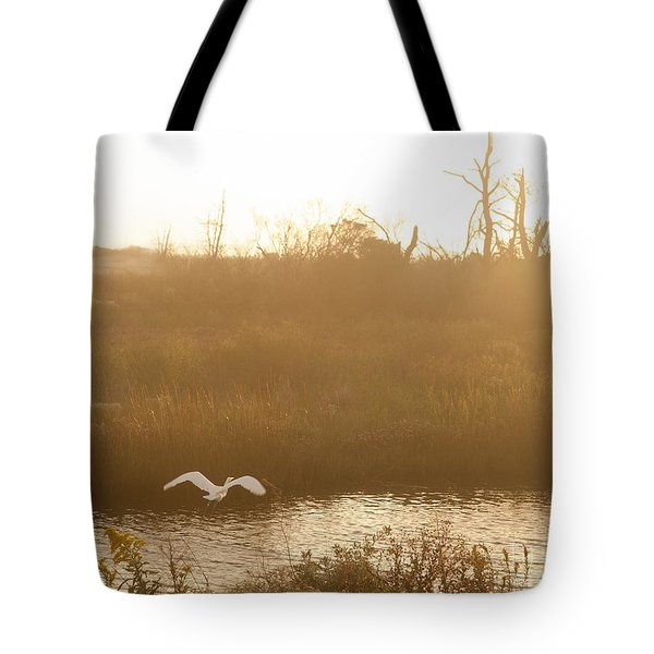 Tote Bag featuring the photograph Taking Off Into A Golden Sunrise by Carol Lynn Coronios