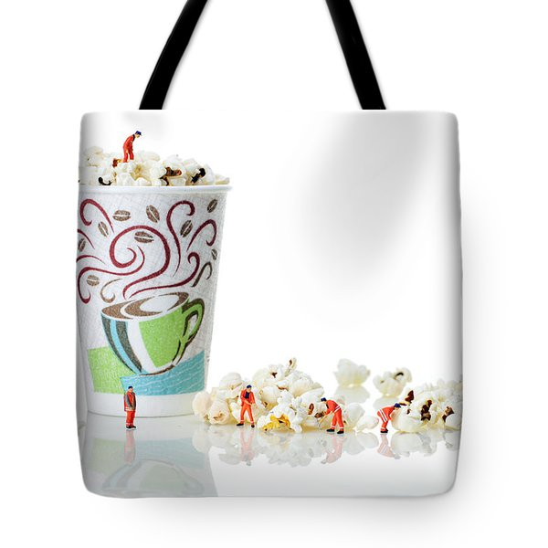 Team Working On Popcorn Tote Bag by Paul Ge