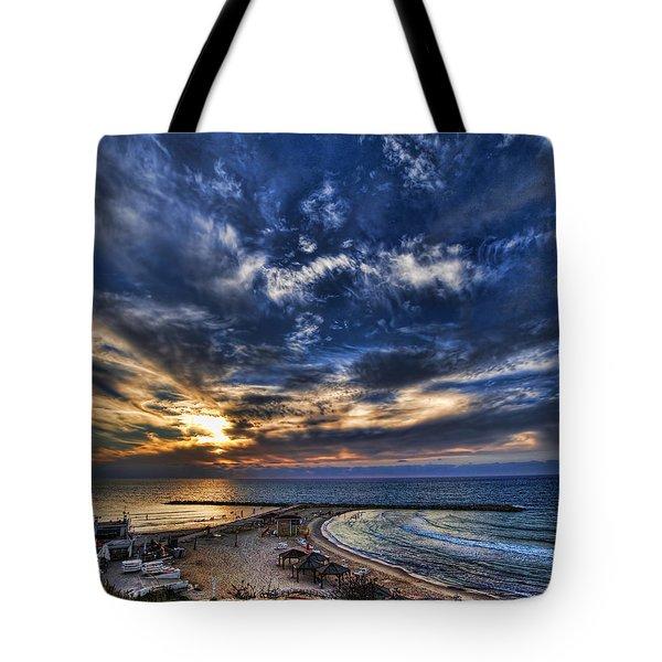 Tote Bag featuring the photograph Tel Aviv Sunset At Hilton Beach by Ron Shoshani