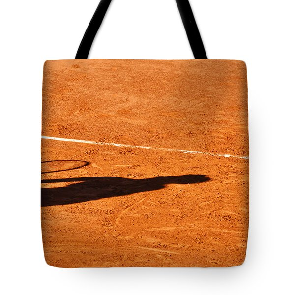 Tennis Player Shadow On A Clay Tennis Court Tote Bag