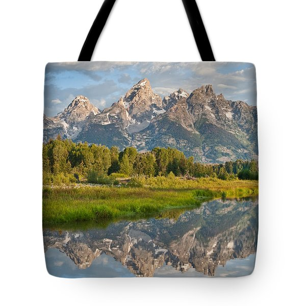 Teton Range Reflected In The Snake River Tote Bag by Jeff Goulden