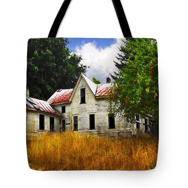The Apple Tree On The Hill Tote Bag by Debra and Dave Vanderlaan