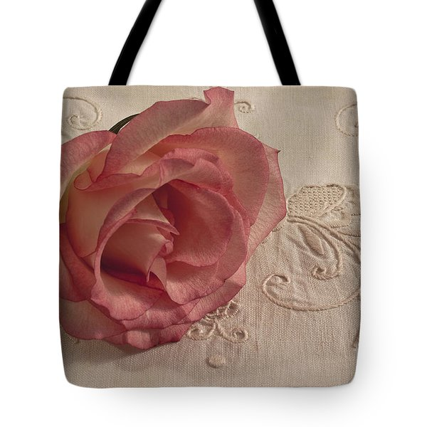 Tote Bag featuring the photograph The Beauty Of Just One Rose by Sandra Foster