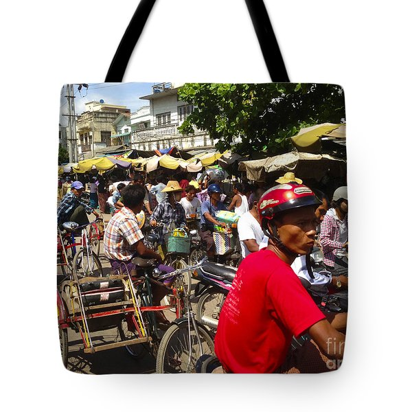 Tote Bag featuring the photograph The Bustling Traffic On 27th Street Zay Cho Street Market Mandalay Burma by Ralph A  Ledergerber-Photography