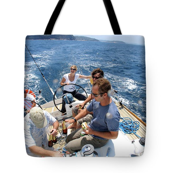 The Crew Enjoys A Cruise Off The Coast Tote Bag