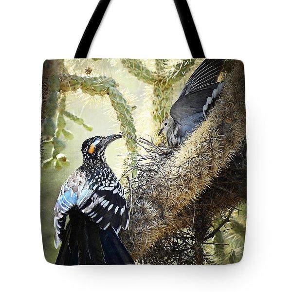 The Dove Vs. The Roadrunner Tote Bag by Saija  Lehtonen