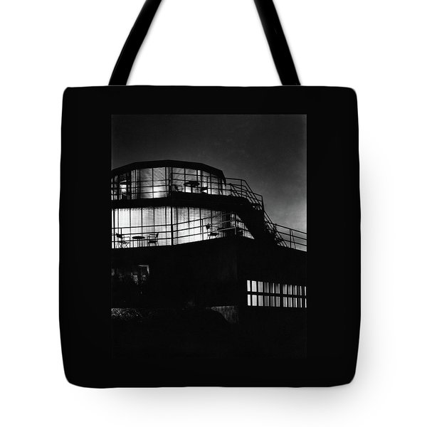 The Exterior Of A Spiral House Design At Night Tote Bag