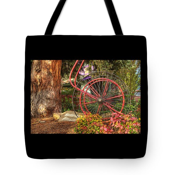 Tote Bag featuring the photograph The Fire Hose Reel by Thom Zehrfeld