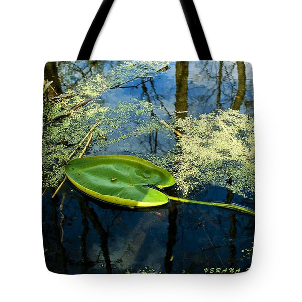 Tote Bag featuring the photograph The Floating Leaf Of A Water Lily by Verana Stark