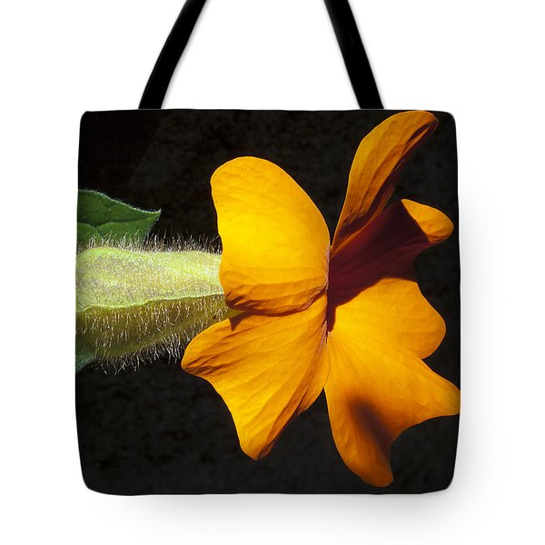 Tote Bag featuring the photograph The Force That Through The Green Fuse ... by Joe Schofield