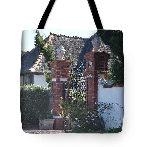Tote Bag featuring the photograph The Gated Castle by Laurie Lundquist