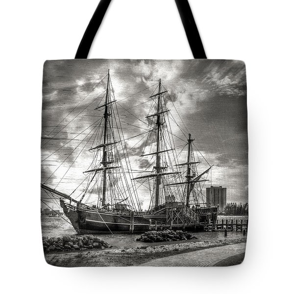 The Hms Bounty In Black And White Tote Bag by Debra and Dave Vanderlaan