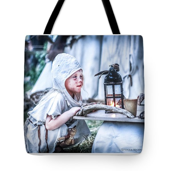 Tote Bag featuring the photograph The Leprosy Child And The Healing Lantern by Stwayne Keubrick