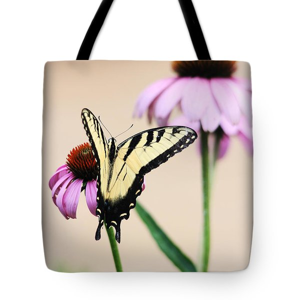 Tote Bag featuring the photograph The Swallowtail by Trina  Ansel