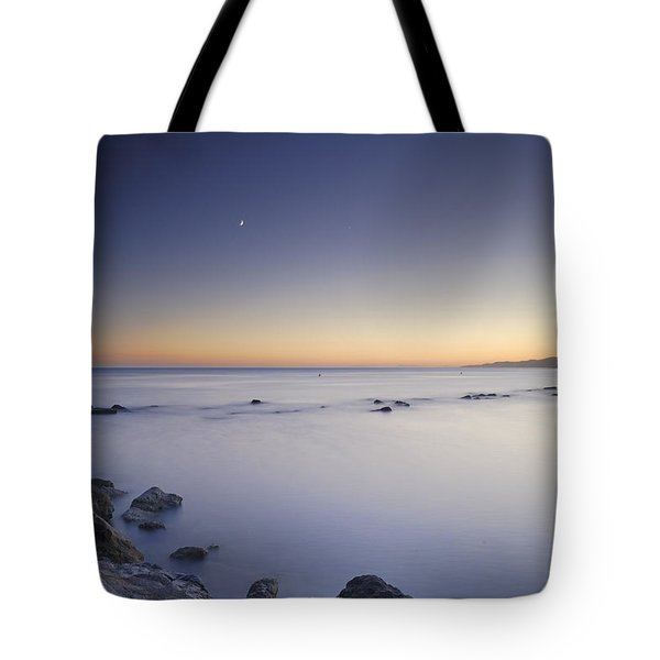 the Moon over the sea Tote Bag by Guido Montanes Castillo