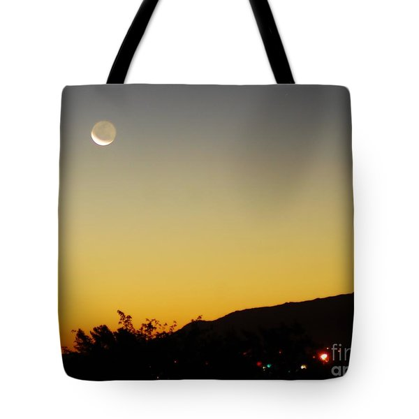 Tote Bag featuring the photograph The Night Moves On by Angela J Wright