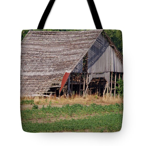 Tote Bag featuring the photograph The Old Gray Barn by Nick Kirby