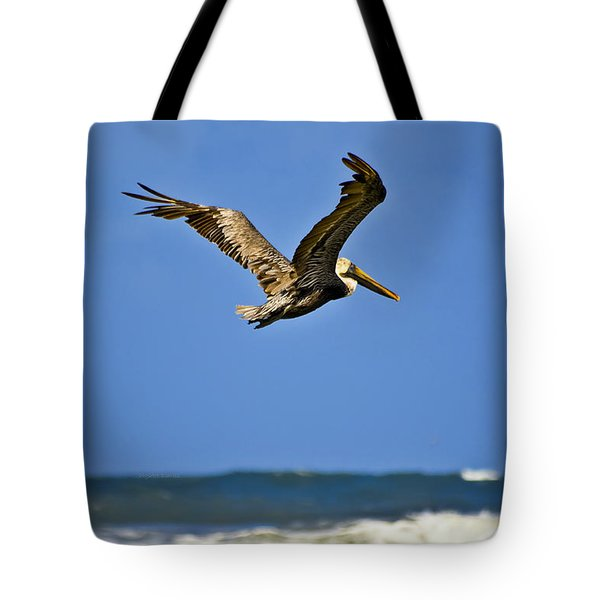 Tote Bag featuring the photograph The Pelican And The Sea by DigiArt Diaries by Vicky B Fuller