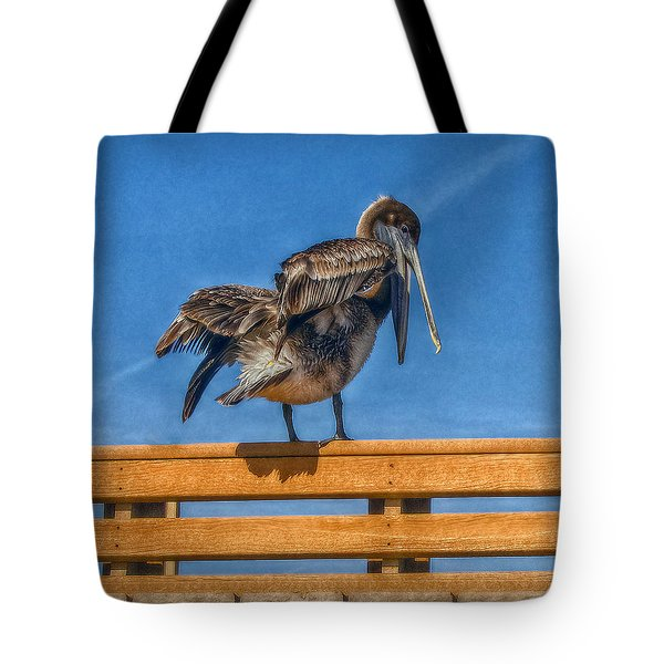 Tote Bag featuring the photograph The Pelican by Hanny Heim