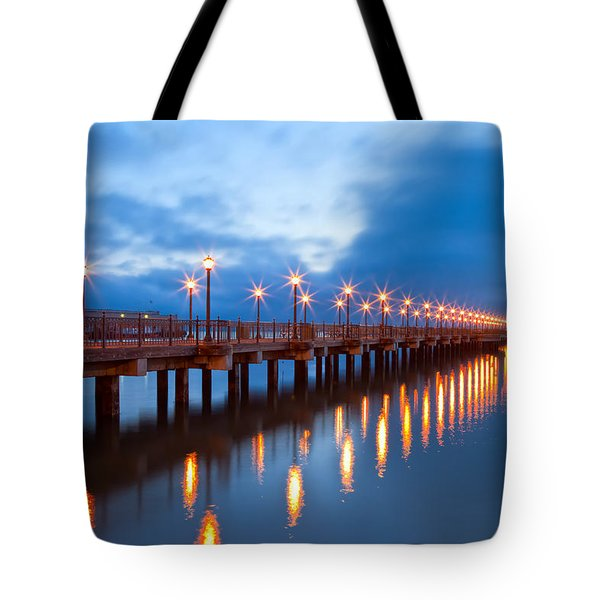 Tote Bag featuring the photograph The Pier by Jonathan Nguyen