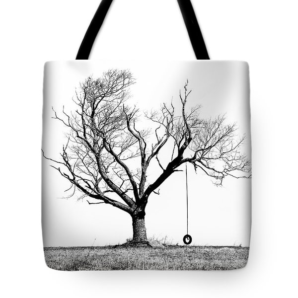 The Playmate - Old Tree And Tire Swing On An Open Field Tote Bag by Gary Heller