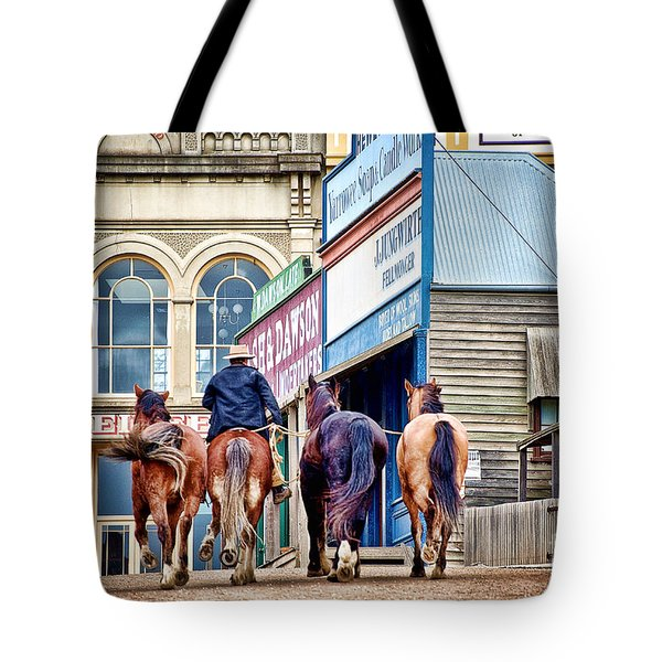Tote Bag featuring the photograph The Rider by Yew Kwang