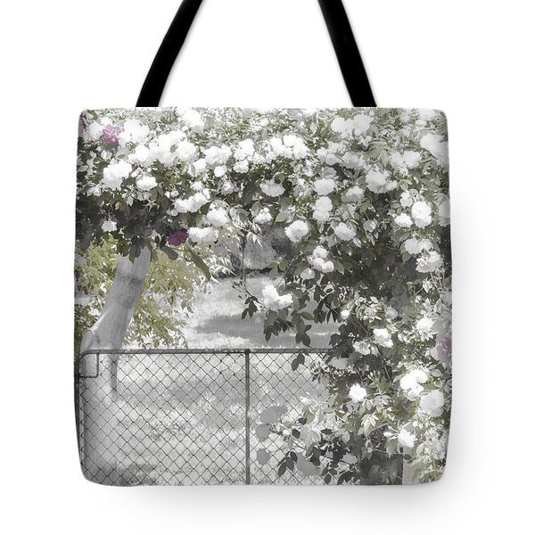 Tote Bag featuring the photograph The Rose Arbor by Elaine Teague