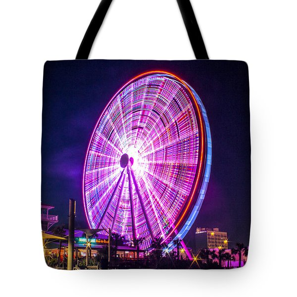 Tote Bag featuring the photograph The Skywheel by Rob Sellers