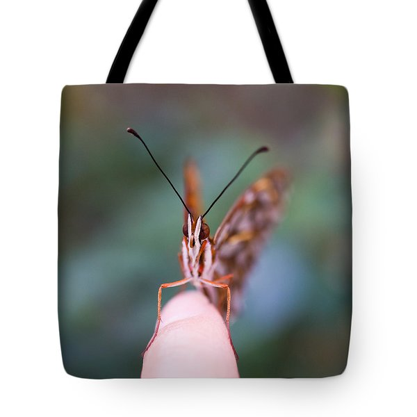 Tote Bag featuring the photograph The Staring Contest by Priya Ghose