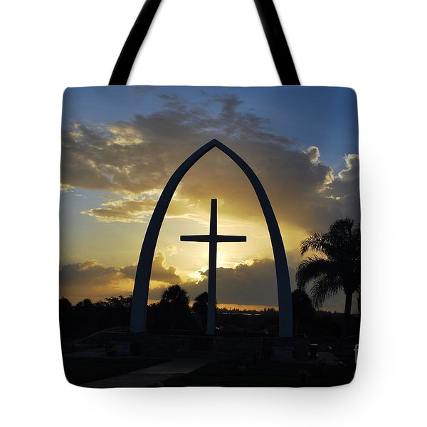Tote Bag featuring the photograph The Universal Cross At Sunrise by Bob Sample