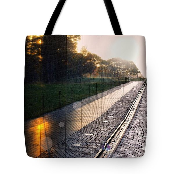 Tote Bag featuring the photograph The Vietnam Wall Memorial  by John S