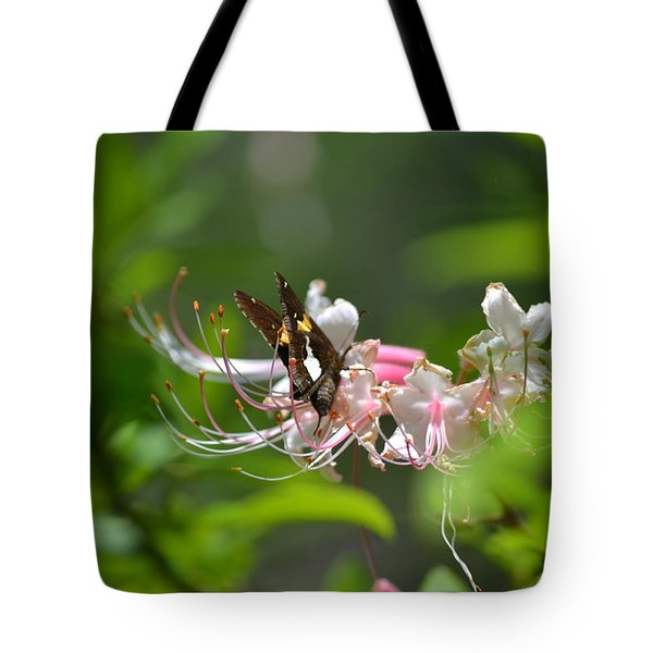 Tote Bag featuring the photograph The Visitor by Tara Potts