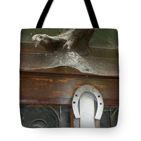 Tote Bag featuring the photograph Thing Above The Door by Newel Hunter