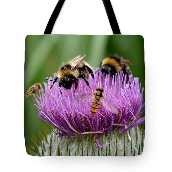 Tote Bag featuring the photograph Thistle Wars by Scott Lyons