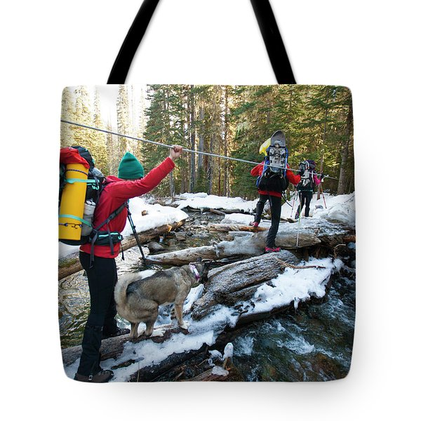 Three Backpackers And A Dog Cross Tote Bag