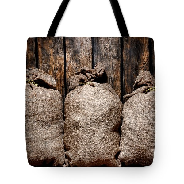 Three Bags In A Warehouse Tote Bag